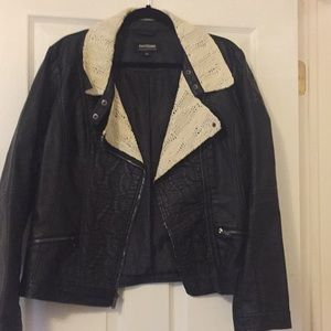 Black faux leather jacket with woven top in lay